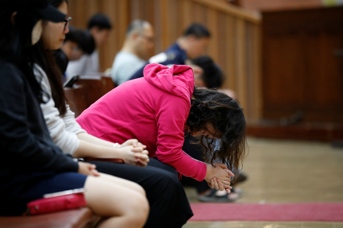 Students pray during an early-morning prayer session at the Presbyterian University and Theological Seminary (PUTS) in Seoul, South Korea, September 12, 2017. Picture taken on September 12, 2017. Photo by Reuters/Kim Hong-Ji