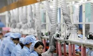 Low-skilled Vietnamese laborers at risk of losing jobs to automation: report