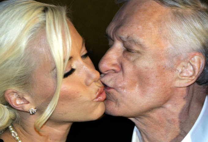 Playboy magazine founder Hugh Hefner kisses his girlfriend Kendra Wilkinson after their arrival for his 80th birthday party in Munichs famous club P1 May 31, 2006. Photo by Reuters/Michaela Rehle/File Photo