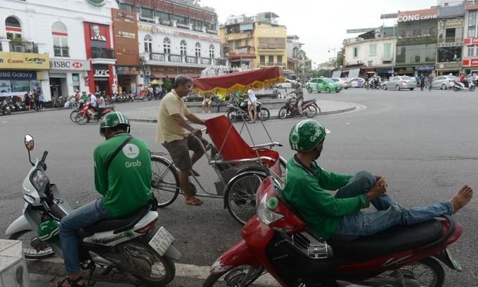 Ride-hailing firm Grab denies allegations of multi-million dollar tax evasion in Vietnam