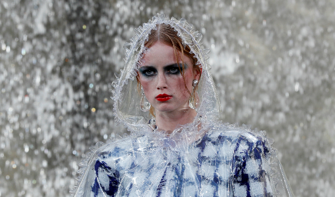 A model presents a creation by German designer Karl Lagerfeld as part of his Spring/Summer 2018 womens ready-to-wear collection show for fashion house Chanel at the Grand Palais during Paris Fashion Week, France, October 3, 2017. Photo by Reuters/Gonzalo Fuentes