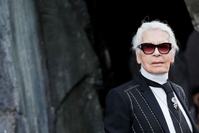 German designer Karl Lagerfeld appears at the end of his Spring/Summer 2018 womens ready-to-wear collection show for fashion house Chanel at the Grand Palais during Paris Fashion Week, France, October 3, 2017. Photo by Reuters/Gonzalo Fuentes