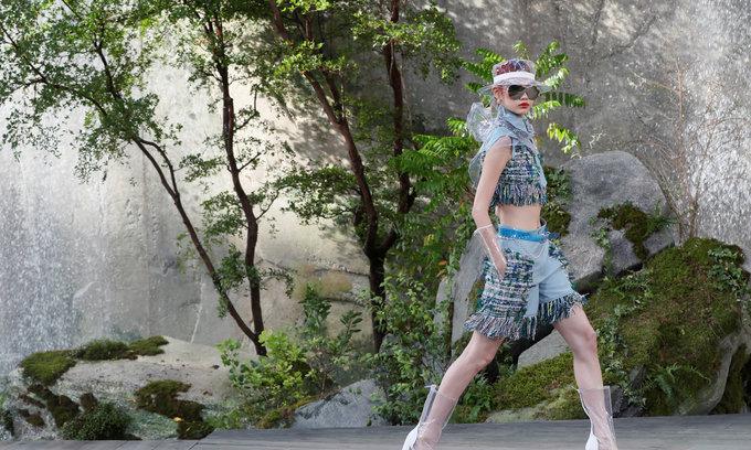 Chanel models parade past Paris waterfalls