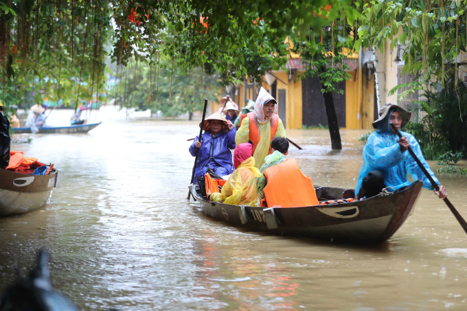 Most tourists and local residents have to use boats to travel from the flood-affected villages and hotels to higher places.