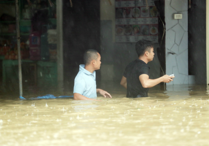 By Sunday noon, floodwater has reached 1.5 meters in some parts of town.
