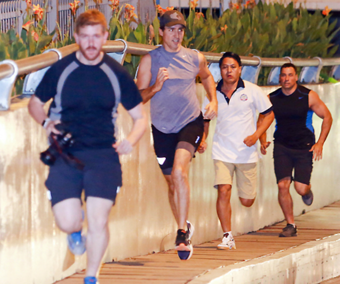 in-vietnams-biggest-city-justin-trudeau-concludes-official-visit-by-jogging-past-locals