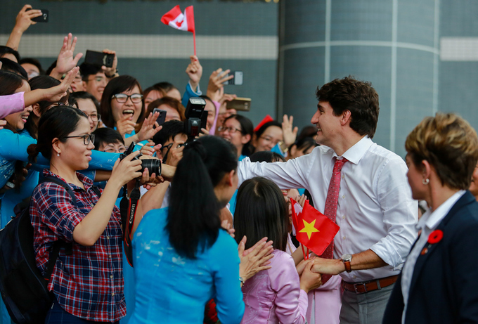 in-vietnams-biggest-city-justin-trudeau-concludes-official-visit-by-jogging-past-locals-9