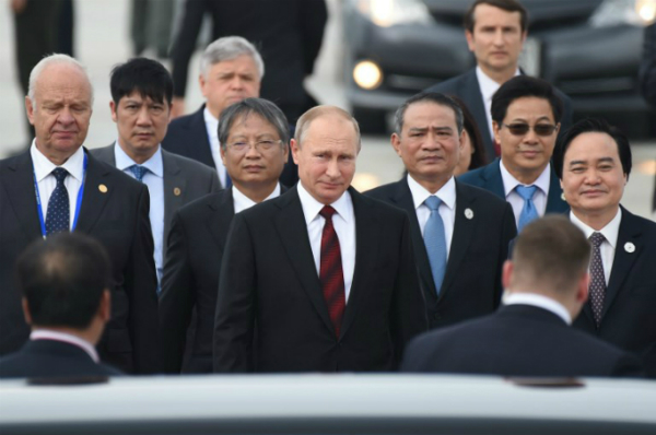 Russias President Vladimir Putin (C) arrives at the international airport ahead of the Asia-Pacific Economic Cooperation (APEC) Summit in the central Vietnamese city of Danang on November 10, 2017. World leaders and senior business figures are gathering in the Vietnamese city of Da Nang this week for the annual 21-member APEC summit. Photo by AFP/Ye Aung Thu