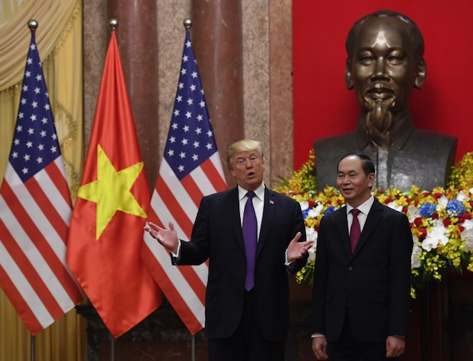 US president Donald Trump (L) gestures as he poses with his Vietnamese counterpart Tran Dai Quang during a welcoming ceremony at the presidential palace in Hanoi on November 12, 2017.