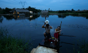In Saigon's backyard, migrants eke out a living on the edge of civilization