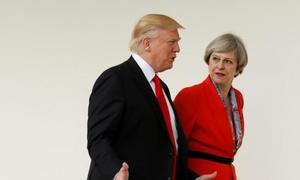 Trump hits out at UK's May over criticism of sharing far right videos