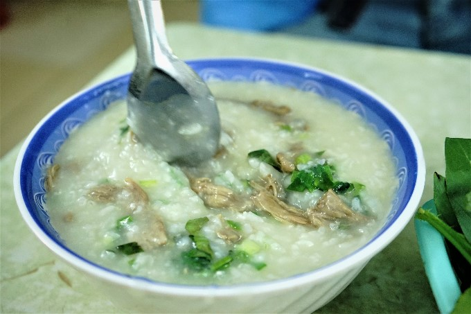 A bubbling hot bowl of duck congee.