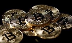 Bitcoin falls 30 percent, posts worst week since 2013