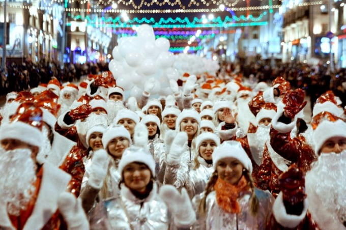 In Belarus, people dressed as Father Frost (as Santa Claus is locally known) and the Snow Maiden walk along a street during a traditional Christmas parade in Minsk, on December 23, 2017. Photo by AFP/Sergei Gapon
