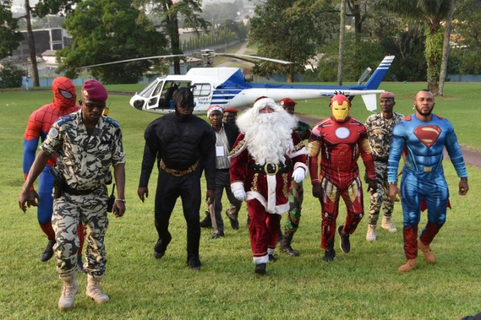 In Ivory Coast, people dressed as (L-R) Batman, Santa Claus, Iron Man and Superman walk at the presidential palace in Abidjan on December 23, 2017, during a Christmas event organised by the Children of Africa Foundation. The event, organised by Ivory Coasts first lady and president of the Children of Africa Foundation, welcomed 3000 children from Abidjan and Agboville. Photo by AFP/Sia Kambou.