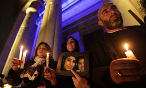 Beirut activists hold vigil in tribute to murdered women