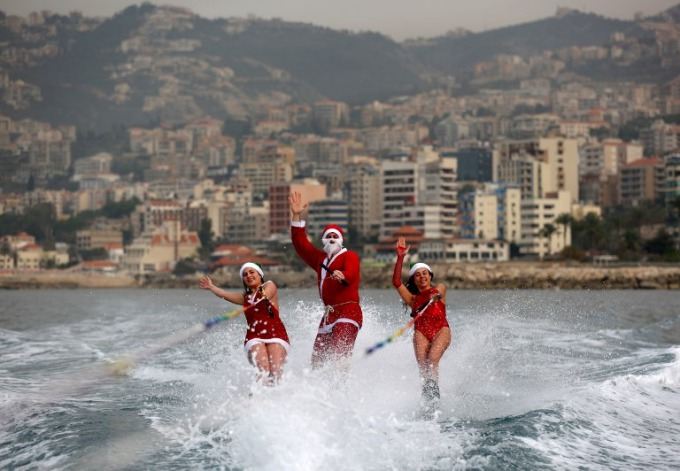 Members of a Lebanese water ski club perform while dressed in Santa Clausoutfits in the bay of Jounieh on December 22, 2017. Photo by AFP/Patrick Baz