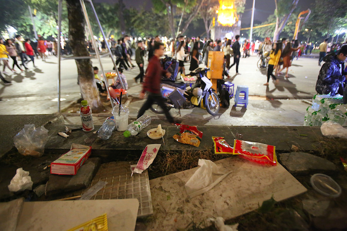 Empty snack packages and water bottles are left behind  on the walking street around the Sword Lake in the heart of Hanoi at 11  p.m. on Christmas Eve.