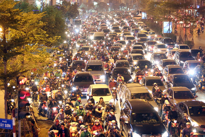 Traffic jam on a street leading to the inner city of Hanoi on Sunday night.