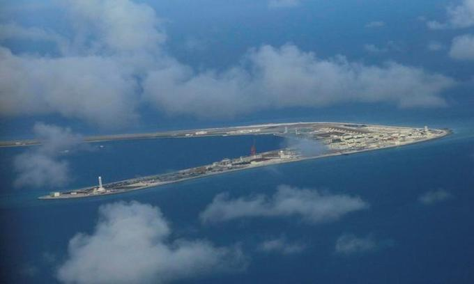 Chinese report says troubled islands expanded 'reasonably'
