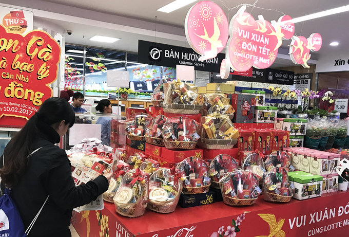 Lunar New Year gift baskets are on display at a supermarket in Hanoi in early 2017. Photo by Ha Phuong