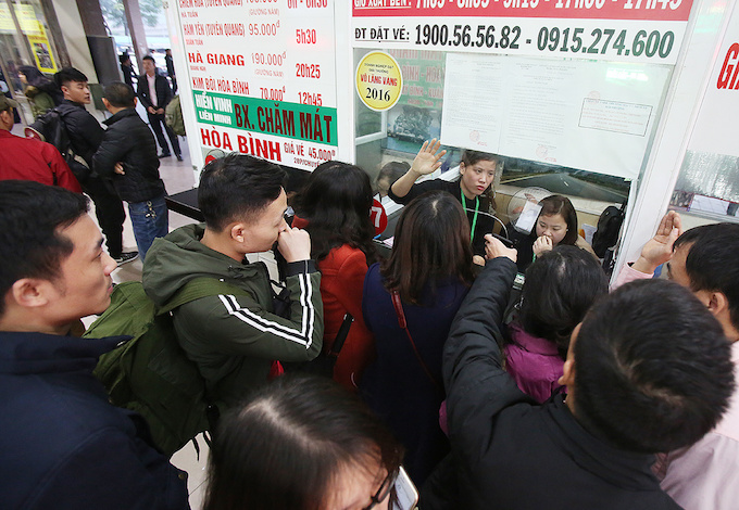 A crowd is seen at a ticket booth in Giap Bat station.