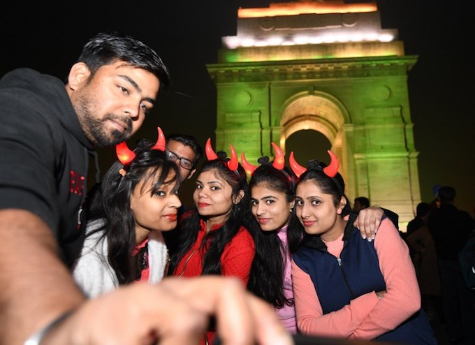 Indian people take a selfie during New Years Eve celebrations at India gate in New Delhi on December 31, 2017.Photo by AFP/Dominique Faget