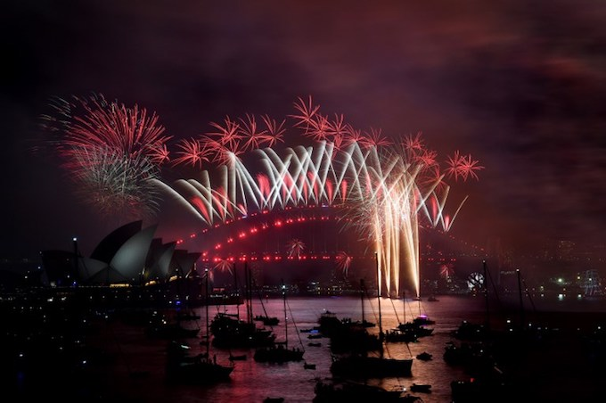 Fireworks light the sky over the Opera House and Harbour Bridge during New Years Eve celebrations in Sydney early on January 1, 2018.Photo by AFP/Saeed Khan.