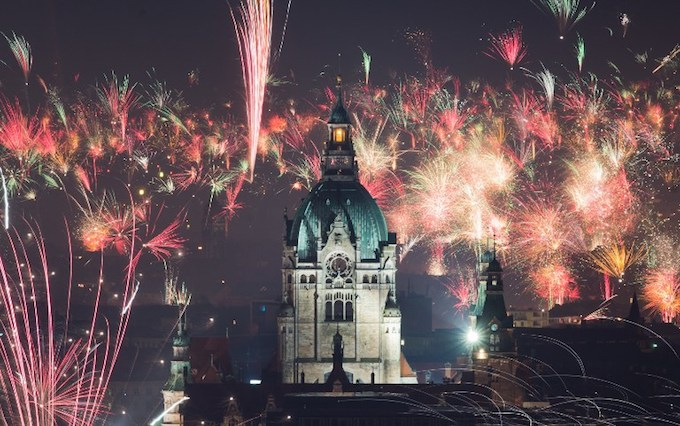 Fireworks explode over the New City Hall of Hanover, northern Germany, on January 1, 2018, to usher in the new year.Photo by AFP/DPA/Julian Stratenschulte