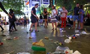 Plastic bags coat Saigon's walking street after raving NYE party