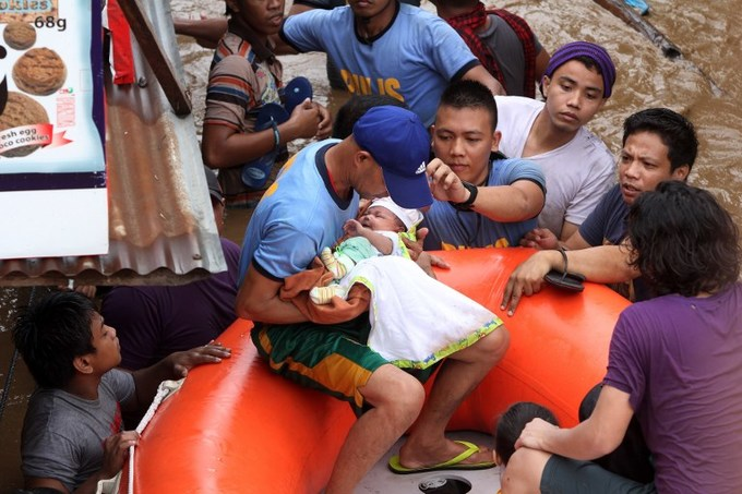 Two dead, thousands flee in storm-weary Philippines