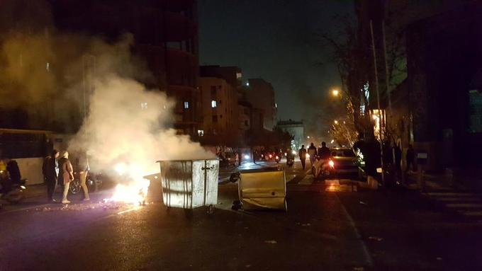 Iranian protesters attack police stations, raise stakes in unrest