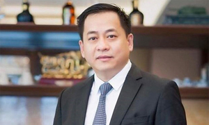 Vietnam arrests wanted property tycoon deported from Singapore