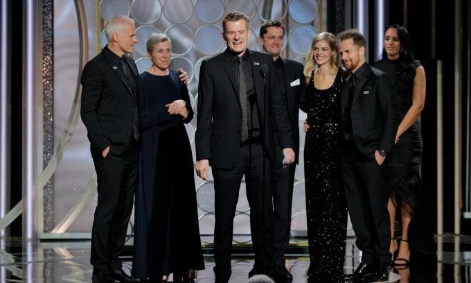 'Three Billboards' wins big as Golden Globes power through sex scandal