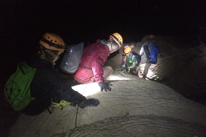 Belts and safety ropes are requested at a section inside Over Cave, where tourists have to get through a wet and high stalactite block.