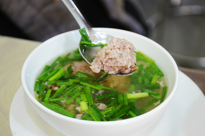 A side bowl of squids costs VND32,000 while an extra bowl meat balls, eggs or noodles cost VND15,000.