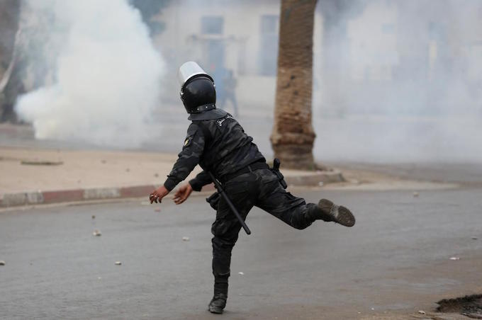Tunisian police clash with protesters in capital as unrest continues