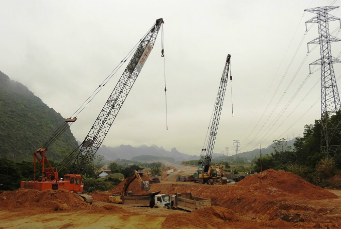 Not far away, trucks are building another expressway from Ha Long to Van Don, a rural district where an international airport is set to open this spring and a special economic zone with a casino has been planned.