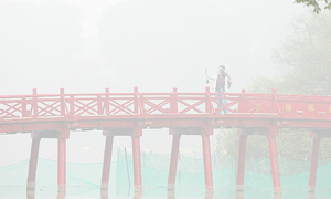 Lost in a dream: Thick fog blankets Hanoi in mystical haze