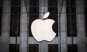 Apple says will pay $38 bn in taxes on repatriated profits