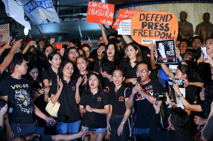Staff of online portal Rappler along with fellow journalists and supporters display placards during a protest in favour of the freedom of press in Manila on January 19, 2018.Photo by AFP/Ted Aljibe