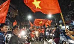 Vietnamese football fans take to streets to celebrate national team's victory
