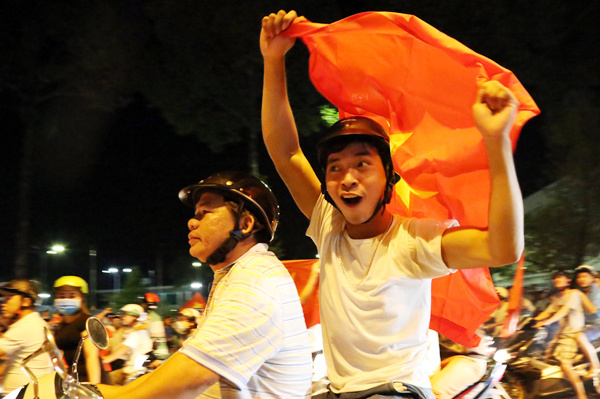In Dong Nai Province in southern Vietnam, the streets are also wide awake with cheers.