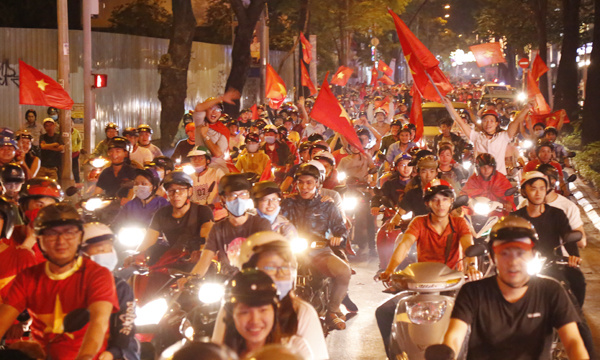 Ho Chi Minh City in the south is also filled with bikers waving Vietnamese flags.