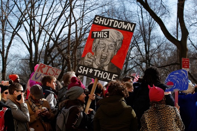 A woman holds a sign during the Second Annual Womens March Chicago on January 20, 2018 in Chicago, Illinois. Photo by AFP/Jim Young