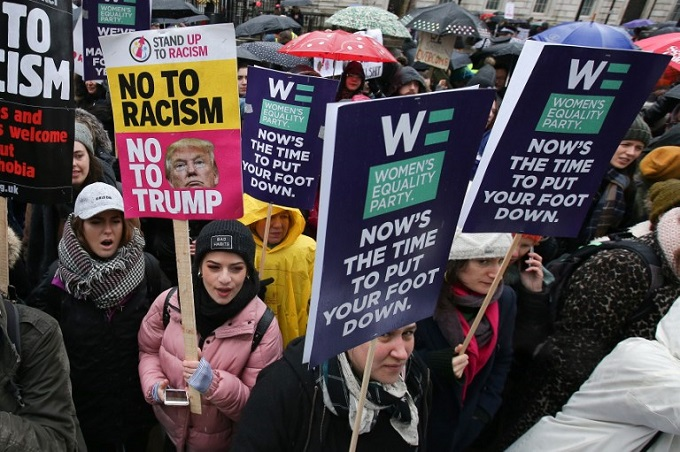 Protesters hold up placards during the Womens March in London on January 21, 2018 as part of a global day of protests, a year to the day since Donald Trump took office as US president. Hundreds of people gathered outside Downing Street in London to voice their frustration at sexual harassment, violence and discrimination against women. Photo by AFP/Daniel Leal-Olivas