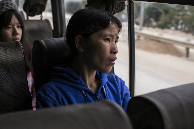 Lan, 32, rides on a bus to visit her family in Thanh Hoa Province, Vietnam for the first time in nine months. Photo courtesy of Oxfam