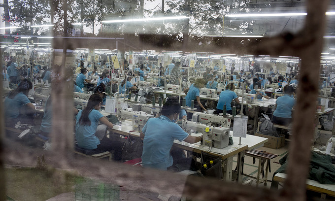 Vietnam's garment workers dangling on a thread at bottom of income divide: Oxfam