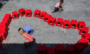 At Saigon orphanage, babies are left with no names and lots of questions