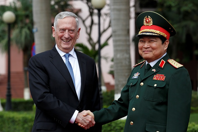 U.S. Secretary of Defense Jim Mattis (L) shakes hands with Vietnams Defence Minister Ngo Xuan Lich during a welcoming ceremony in Hanoi, Vietnam. Photo by Reuters/Kham
